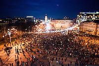 People that have been dispersed regather at nigh in front of the nearby Mykhailiv monastery to continue the  protest  after the violent repression  on main square perfomed by the riot police, Kiev.