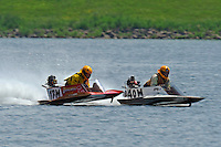 Andy Tate (17-M) catches some air as he races 40-M up the back straight. (hydro)