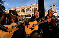Street musicians play outside of Pike Place Market in Seattle Washington.