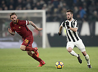 Calcio, Serie A: Juventus - AS Roma, Torino, Allianz Stadium, 23 dicembre, 2017. <br /> Juventus' Miralem Pjanic (r) in action with Roma's captain Daniele De Rossi (l) during the Italian Serie A football match between Juventus and Roma at Torino's Allianz stadium, December 23, 2017.<br /> UPDATE IMAGES PRESS/Isabella Bonotto