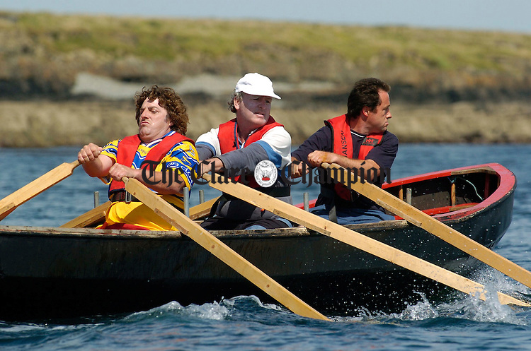 Competitors battle it out during the currach racing as part of the Kilbaha Gathering festival. Photograph by John Kelly.
