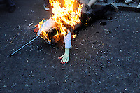An effigy of a banker burns outside the Bank of England as thousands of protestors descended on the City of London ahead of the G20 summit of world leaders to express anger at the economic crisis, which many blame on the excesses of capitalism.