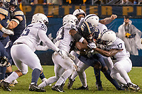 Penn State safety Ayron Monroe (23), linebacker Jarvis Miller (9) and safety Garrett Taylor (17) gang tackle Pitt running back Darrin Hall. The Penn State Nittany Lions defeated the Pitt Panthers 51-6 on September 08, 2018 at Heinz Field in Pittsburgh, Pennsylvania.