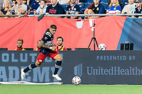 FOXBOROUGH, MA - JULY 7: Gustavo Bou #7 of New England Revolution brings the ball forward during a game between Toronto FC and New England Revolution at Gillette Stadium on July 7, 2021 in Foxborough, Massachusetts.