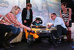 Isaac Young, 3, checks out his new Hummer at the Make-A-Wish Waffles & Wishes event at the Atlantis Casino Resort Spa in Reno, Nev., on Tuesday, March 26, 2013..Photo by Cathleen Allison