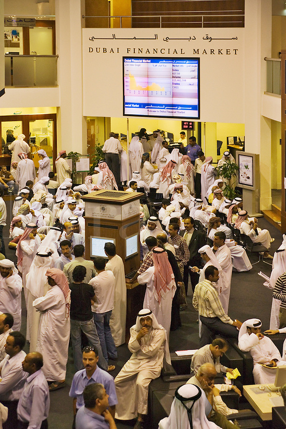 Investors at the Dubai Financial Market, the local Stock Exchange,  check the latest prices.  Dubai. United Arab Emirates.
