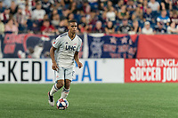 FOXBOROUGH, MA - AUGUST 4: Brandon Bye #15 of New England Revolution brings the ball forward during a game between Los Angeles FC and New England Revolution at Gillette Stadium on August 3, 2019 in Foxborough, Massachusetts.