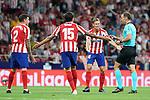 Atletico de Madrid's Jose Maria Gimenez, Stefan Savic and Marcos Llorente have words with Spanish referee Guillermo Cuadra Fernandez during La Liga match. August 18,2019. (ALTERPHOTOS/Acero)