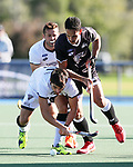 Zander Fraser of North is tackled by Robbie Capizzi of South during the Men's North v South hockey match, St Pauls Collegiate, Hamilton, New Zealand. Saturday 17 April 2021 Photo: Simon Watts/www.bwmedia.co.nz
