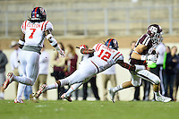 Texas A&M wide receiver Boone Niederhofer (82) slips past Ole Miss defensive back Tony Conner (12) during second half of an NCAA football game, Saturday, October 11, 2014 in College Station, Tex. Ole Miss defeated Texas A&M 35-20. (Mo Khursheed/TFV Media via AP Images)