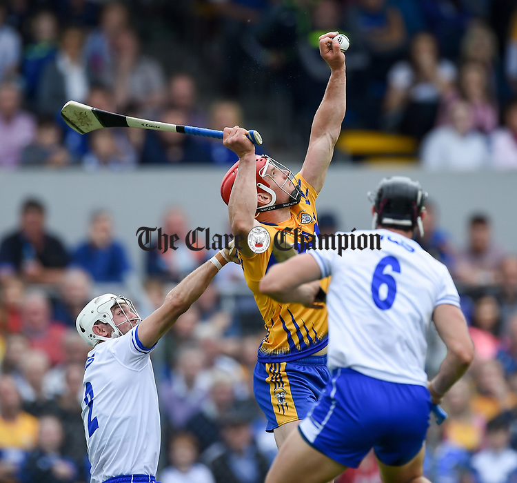 John Conlon of Clare  in action against Shane Fives and Darragh Fives of Waterford during their Munster  championship round robin game at Cusack Park Photograph by John Kelly.