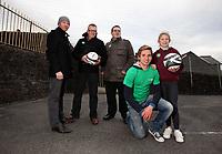 Pictured: Joe Allen (in green) with10 year Mai Watkins (R). Thursday 27 January 2011<br /> Re: Swansea City football player Joe Allen visiting Y Wern Welsh School in Ystalyfera, south Wales.