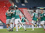 Jason Cummings mobbed after scoring the winner in the penalty shootout