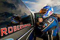 Oct. 31, 2008; Las Vegas, NV, USA: NHRA funny car driver Robert Hight puts on his safety gear during qualifying for the Las Vegas Nationals at The Strip in Las Vegas. Mandatory Credit: Mark J. Rebilas-