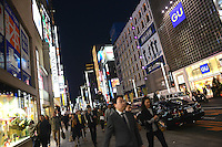 Shoppers in the up-market shopping district,  Ginza, Tokyo, Japan.<br /> April-2014