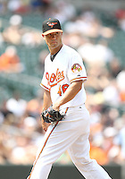 Pitcher Jeremy Guthrie of the Baltimore Orioles looks towards first base during a MLB game against the Chicago White Sox at Camden Yards, on August 8 2010, in Baltimore, Maryland. Orioles won 4-3.