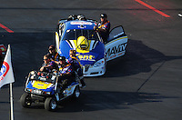 Apr. 13, 2012; Concord, NC, USA: NHRA pro stock driver Rodger Brogdon is towed back to the pits by crew members during qualifying for the Four Wide Nationals at zMax Dragway. Mandatory Credit: Mark J. Rebilas-