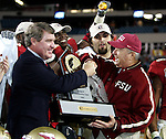 Florida State University head coach Bobby Bowden (R) shakes hands with Atlantic Coast Conference Commissioner John Swofford (L) as Swofford presents the ACC championship trophy after Florida State's 27-22 win over Virginia Tech in the inaugural ACC championship NCAA football game in Jacksonville, Florida December 3, 2005.    (Mark Wallheiser/TallahasseeStock.com)