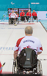 Sochi, RUSSIA - Mar 10 2014 -  Jim Armstrong looks on as Dennis Thiessen makes a shot during Canada vs USA in Wheelchair Curling round robin play at the 2014 Paralympic Winter Games in Sochi, Russia.  (Photo: Matthew Murnaghan/Canadian Paralympic Committee)