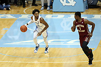 CHAPEL HILL, NC - FEBRUARY 1: Leaky Black #1 of the University of North Carolina brings the ball up the court while defended by Jairus Hamilton #1 of Boston College during a game between Boston College and North Carolina at Dean E. Smith Center on February 1, 2020 in Chapel Hill, North Carolina.