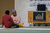 Two Men Talking after Prayers at Masjid Al-Islah, Al-Islah Mosque, Singapore.