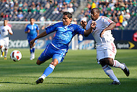 El Salvador's Victor Turcios holds off Cuba's Roberto Linares as he prepares to clear the ball.  El Salvador defeated Cuba 6-1 at the 2011 CONCACAF Gold Cup at Soldier Field in Chicago, IL on June 12, 2011.