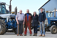 BNPS.co.uk (01202) 558833. <br /> Pic: Cheffins/BNPS<br /> <br /> Pictured: Ian, Martin, Suzanne and Jed Liddle with tractors in the collection. <br /> <br /> A farming family is today celebrating after their incredible collection of almost 100 vintage tractors sold for a staggering £1million.<br /> <br /> Father and son duo Ian and Martin Liddell began hoarding the agricultural vehicles at their arable farm in the 1980s.<br /> <br /> Their fleet of tractors was so large that they had to be stored in three barns.<br /> <br /> The prized collection sparked a worldwide bidding war when it was sold with auctioneers Cheffins, of Cambridge, after the family decided to part with the tractors to free up space on their Essex farm to pursue other projects.
