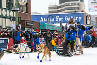 Wade Mars and team leave the ceremonial start line with an Iditarider and handler at 4th Avenue and D street in downtown Anchorage, Alaska on Saturday March 7th during the 2020 Iditarod race. Photo copyright by Cathy Hart Photography.com
