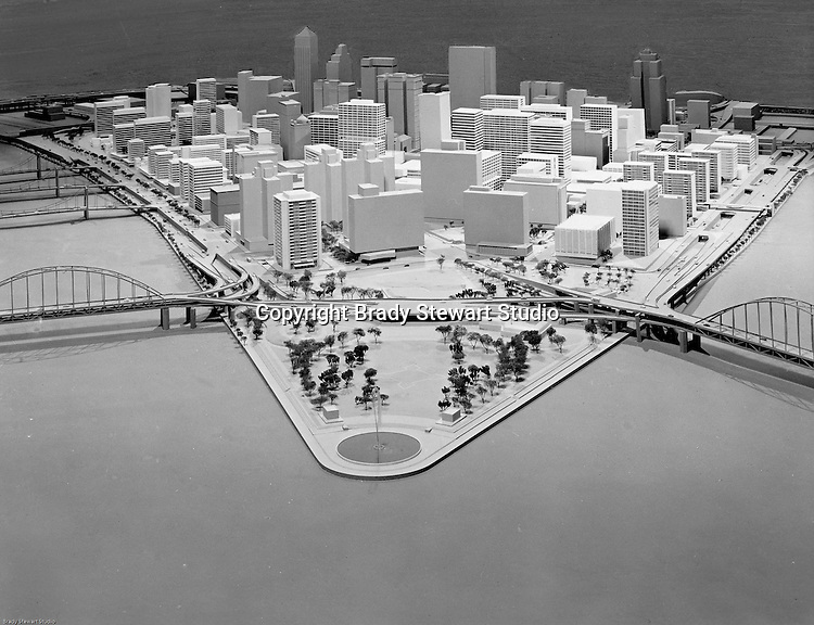 Pittsburgh PA:  Pittsburgh Regional Planning Association hired an Architect to create a rendering of the projected development in downtown Pittsburgh.  New construction is highlighted with the buildings with windows situated throughout the city.