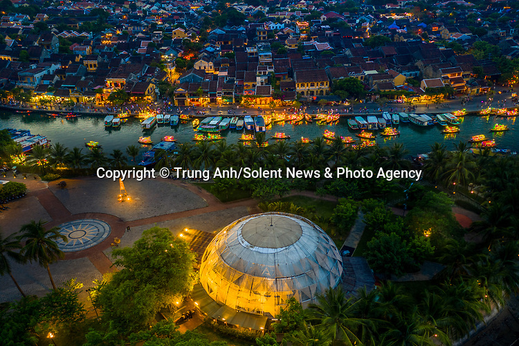 "A fleet of glowing boats transport tourists along a canal in Hoi An, Vietnam.<br /> <br /> The luminous vessels were captured from above by  photographer Trung Anh.<br /> <br /> Trung said, ""To stimulate tourism following the coronavirus pandemic, boat owners have decorated their boats like this to make them more attractive.  I think they look like leaves floating in the river.""<br /> <br /> Please byline: Trung Anh/Solent News<br /> <br /> © Trung Anh/Solent News & Photo Agency<br /> UK +44 (0) 2380 458800"