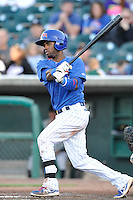 Arismendy Alcantara #5 of the Iowa Cubs swings against the Omaha Storm Chasers at Principal Park on July 2, 2014 in Des Moines, Iowa. The Cubs  beat Storm Chasers 4-3.   (Dennis Hubbard/Four Seam Images)