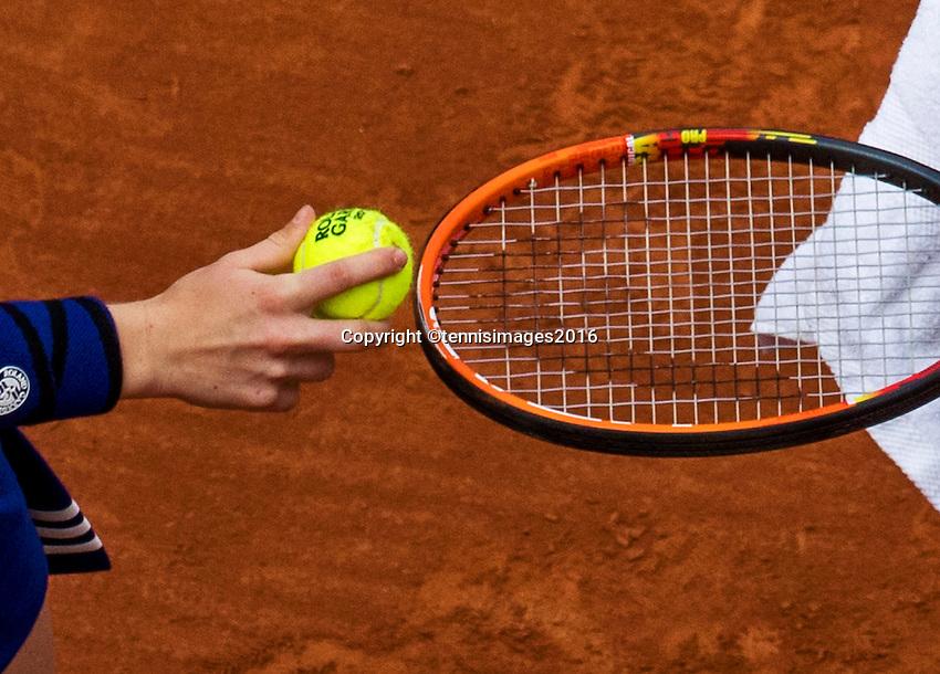 Paris, France, 22 June, 2016, Tennis, Roland Garros, ballkid hands a tennisbal to a player<br /> Photo: Henk Koster/tennisimages.com