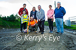 Residents in Kilmoyley seriously concerned about the safety and the state of the road near in Tochar Bán, l to r: Aoife and Tomas Aylward, Paddy O'Sullivan, Liz Denault, Mike Griffin, Kathleen O'Sullivan and Des Griffin.