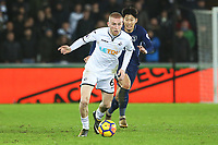 Oliver McBurnie of Swansea City is chased by Son Heung-min of Tottenham Hotspur during the Premier League match between Swansea City and Tottenham Hotspur at the Liberty Stadium, Swansea, Wales, UK. Tuesday 02 January 2018