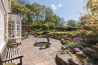 BNPS.co.uk (01202) 558833. <br /> Pic: SandersonYoung/BNPS<br /> <br /> Outside patio.<br /> <br /> A quirky 'show home' for a brickwork owner where Lewis Carroll is believed to have stayed while writing some of his Alice in Wonderland books is on the market for just under £1m.<br /> <br /> Red Cottage is a striking Grade II listed property in Whitburn, Tyne and Wear, where Charles Dodgson, otherwise known as Lewis Carroll, regularly visited family.<br /> <br /> The unusual 179-year-old home was built to show off as many design features as possible, and has a walled garden and even an air raid shelter.