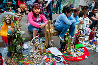 Mexican followers of Santa Muerte (Saint Death) gather to attend a mass outside the shrine in Tepito, a rough neighborhood of Mexico City, Mexico, 1 June 2011. The religious cult of Santa Muerte is a syncretic fusion of Aztec death worship rituals and Catholic beliefs. Born in lower-class neighborhoods of Mexico City, it has always been closely associated with crime. In the past decades, original Santa Muerte's followers (such as prostitutes, pickpockets and street drug traffickers) have merged with thousands of ordinary Mexican Catholics. The Saint Death veneration, offering a spiritual way out of hardship in the modern society, has rapidly expanded. Although the Catholic Church considers the Santa Muerte's followers as devil worshippers, on the first day of every month, crowds of believers in Saint Death fill the streets of Tepito. Holding skeletal figurines of Holy Death clothed in a long robe, they pray for power healing, protection and favors and make petitions to 'La Santísima Muerte', who reputedly can make life-saving miracles.
