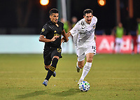 LAKE BUENA VISTA, FL - JULY 18: Mohamed El-Munir #13 of LAFC fights off the challenge by Sacha Klestan #16 of LA Galaxy during a game between Los Angeles Galaxy and Los Angeles FC at ESPN Wide World of Sports on July 18, 2020 in Lake Buena Vista, Florida.