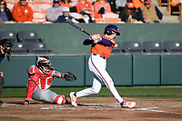 First baseman Dylan Brewer (3) of the Clemson Tigers bats in a game against the Stony Brook Seawolves on Friday, February 21, 2020, at Doug Kingsmore Stadium in Clemson, South Carolina. The Seawolves catcher is John Tuccillo (45). Clemson won, 2-0. (Tom Priddy/Four Seam Images)
