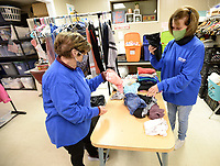 Volunteers Judy Schaap (left) and Diane Lovell sort clothing Wednesday, Jan. 13, 2021, at His Helping Hands Clothes Closet in downtown Springdale. The mission is operated by volunteers with the First United Methodist Church and provides free clothing from 9 a.m. to 2 p.m. Wednesdays and Thursdays to those in need. Visit nwaonline.com/210114Daily/ for today's photo gallery. <br /> (NWA Democrat-Gazette/Andy Shupe)
