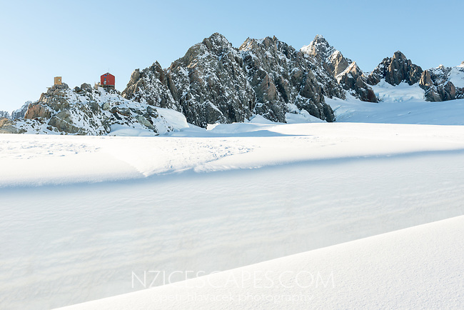 Crevasses with Pioneer Hut and Douglas Peak on right in upper parts of Fox Glacier NEVE, Westland Tai Poutini National Park, West Coast, UNESCO World Heritage Area, New Zealand, NZ