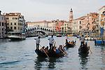 Venice Italy 2009. Grand Canal. Tourism Gondolas. Rialto Bridge in background.