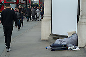 Rough sleeper and shoppers  in Regent Street London