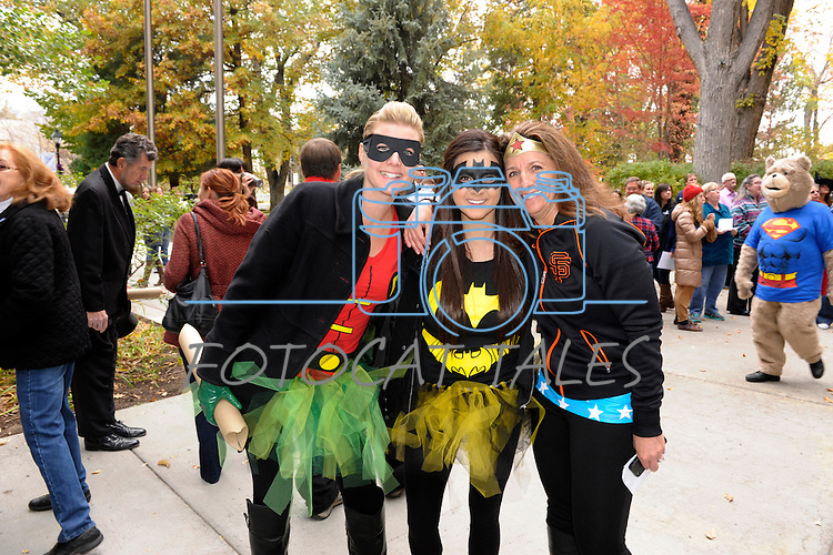 """Kelly Frantz, Dayton, left, Skylar Petersen, Reno, and Ann Scott, Carson City mugg for the camera Thursday, Oct. 30, 2014 during #NevadaSings!, a statewide sing-a-long of """"Home Means Nevada."""" Approximately 370 people took part  in the Carson City portion of the event, which seeks to establish a new record for the most people in an American state to sing their state song at the same time."""