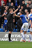 ATTENTION SPORTS PICTURE DESK<br /> Pictured: Michael Chopra of Cardiff (R) protesting to match referee M Jones (L) for disallowing his goal.<br /> Re: npower Championship, Cardiff City FC v Swansea City Football Club at the Cardiff City Stadium, south Wales. Sunday 07 November 2010