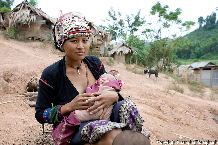 An Akha woman holds her newborn at a village in Luang Namtha, Laos on November 8, 2009.   (Photo by Khampha Bouaphanh)