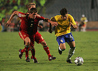 Brazil's Diogo (6) moves the ball past Germany's Sebastian Jung (2) and Lewis Holtby (10) during the FIFA Under 20 World Cup Quarter-final match at the Cairo International Stadium in Cairo, Egypt, on October 10, 2009. Germany lost 2-1 in overtime play.