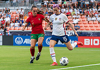 HOUSTON, TX - JUNE 10: Megan Rapinoe #15 of the USWNT is defended by Joana Marchao #5 of Portugal during a game between Portugal and USWNT at BBVA Stadium on June 10, 2021 in Houston, Texas.