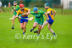 Jackie Horgan gets through the tackle from Clare's Aoife Griffin and Niamh Mulqueen in the Munster Junior Camogie final