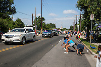 AUSTIN, TEXAS - Children race to pick up candy off the street thrown by parade floats at the 2016 Central Texas Juneteenth Celebration Parade in East Austin, Texas.<br /> <br /> Juneteenth marks the anniversary of June 19, 1865, the day slaves in Texas learned they were free, two years after President Abraham Lincoln signed the Emancipation Proclamation.<br /> <br /> Use of this image in advertising or for promotional purposes is prohibited.<br /> <br /> Editorial Credit: Photo by Dan Herron / Herron Stock