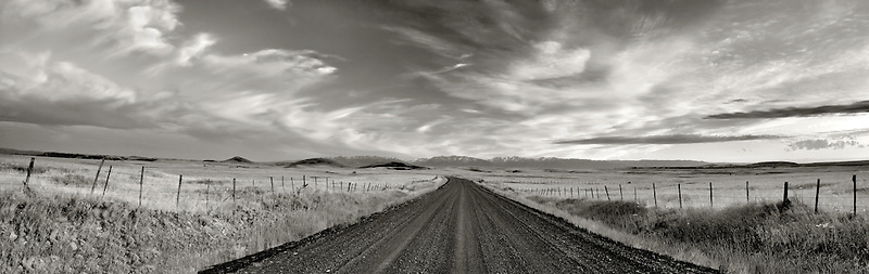 Road in Zumwalt Prairie with Wallowa Mountains. Oregon